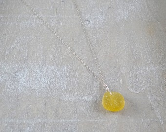 Bright yellow sea glass coin on a sterling silver chain