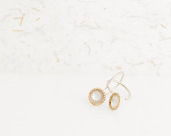 silver earrings with golden rim