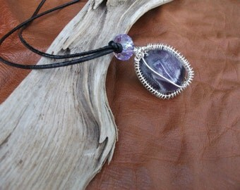Amethyst, chunky stone pendant surrounded by silver wire wrapping & hung on leather cord.