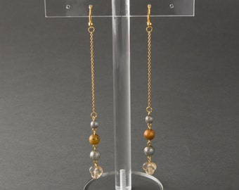 "Earrings with long gloden chain.Dangling earrings.Beige,Grey and Transparent beads.""Drips"""