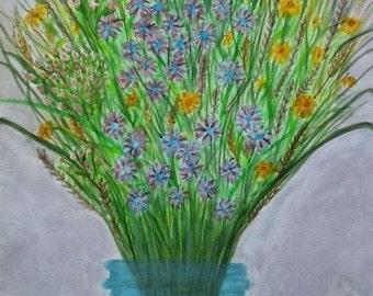 Wildflowers in blue glass