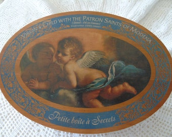 French vintage, oval lidded, wooden sweets box. The lid features cherubs which is an extract from an original oil painting.