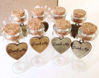Mini glass bottles with Drink Me/Eat Me heart charm wedding favour/decoration