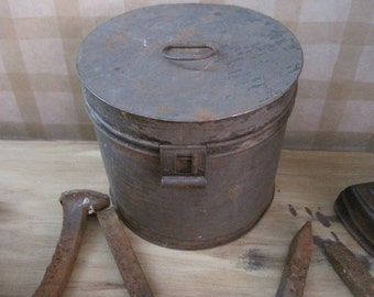 Vintage old rusty metal tin canister