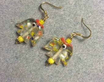 Transparent with yellow and red spots lampwork fish bead earrings adorned with yellow Czech glass beads.