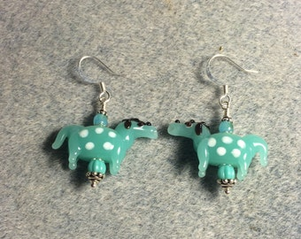 Milky turquoise with white spots lampwork horse bead earrings adorned with turquoise Czech glass beads.
