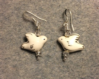 White ceramic dove bead earrings adorned with clear Chinese crystal beads.
