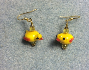 Yellow lampwork chick bead earrings adorned with yellow Chinese crystal beads.
