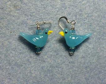 Turquoise lampwork songbird bead dangle earrings adorned with turquoise Chinese crystal beads.