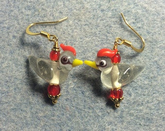 Transparent red crested lampwork bird bead earrings adorned with red Czech glass beads.