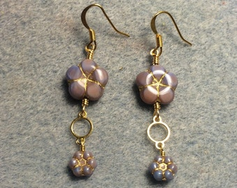 Purple pink Czech glass puffy flower bead dangle earrings adorned with gold circle connectors and purple pink Czech glass poppy beads.