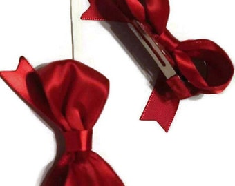 Red satin bow clip