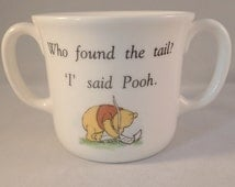 "Royal Doulton Winnie The Pooh Children's Mug – ""Who found the tail? 'I' said Pooh"""