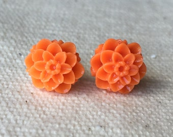 Orange resin dahlia flower stud earrings