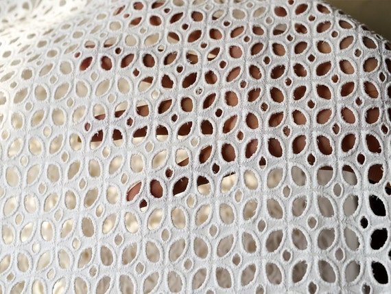 White eyelet fabric embroidered cotton by the