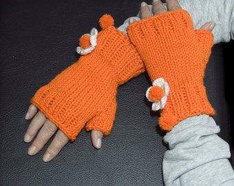 Fingerless gloves woman teenager flowers pompom knitted mitts mittens fashion trend autumn fall winter orange