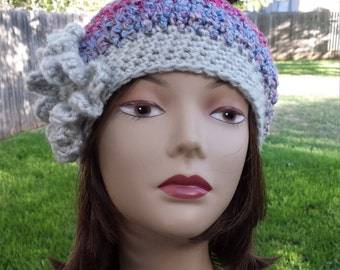 Winter hat  with flower crochet made by  petronella