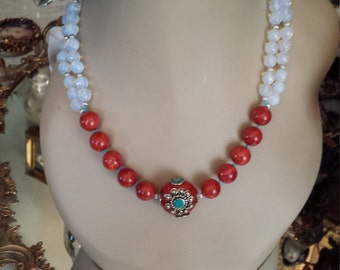 Two strand beaded necklace made with faceted opulite and sponge coral