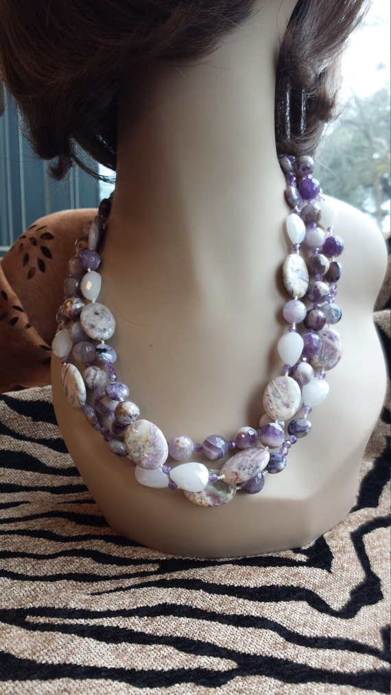Three strand necklace made with faceted amythyst, artist glass cut faceted beads and jasper
