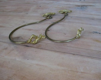 2 the same  brass French embrasses, curtain suspenders, curtain tie-backs.