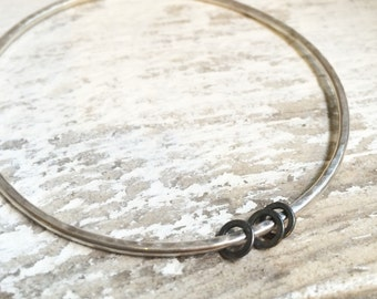 Solid silver bangle with oxidised silver  rings