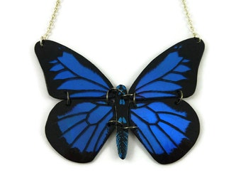 Iridescent royal blue and black Papilio Ulysses butterfly necklace, dark blue and black butterfly necklace, plastic butterfly necklace