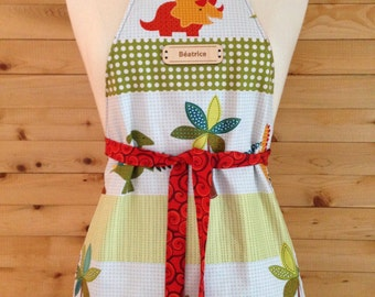 Apron kitchen for children from 2 to 8 years. Reversible. Unisex. Dinosaurs. Orange. Possibility to customize.