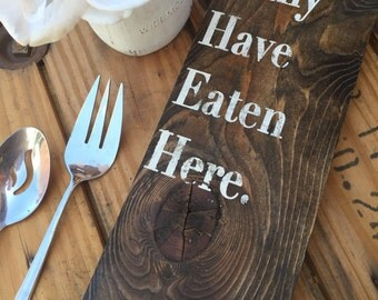 Many have eaten here (sarcastic wooden sign)