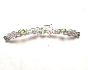ADJ 925 sterling silver bracelet with 7 green gem (B76)