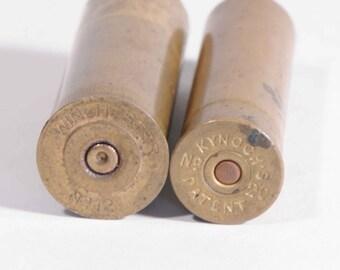 Antique brass shot gun shell casings, Winchester No. 12 and Kynoch's No. 20