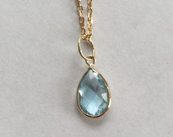 14k solid yellow gold and blue topaz charm, pear shaped
