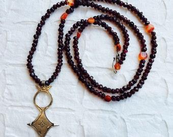 Long garnet and carnelian necklace with Tuereg cross pendant