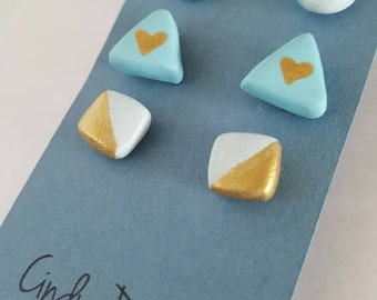 Blue and gold earring set.