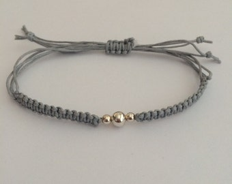 Braided macrame friendship bracelet with sterling silver beaded design. Friendship gift
