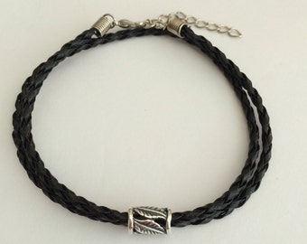 Mens black leather braided raceket with sterling silver tube bead and clasp. Leather braid bracelet. Mens jewellery