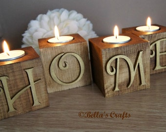 Wooden blocks with candle.  Set of 4 wooden blocks spelling HOME each with a candle. Handmade