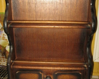 A spice drawer wooden shelf. Storage for spices.