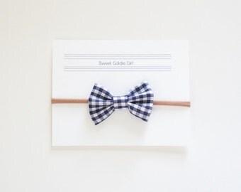 Navy Blue Gingham small bow on nylon headband or clip