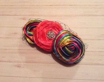 Flower headband in Hot Pink, black, blue, yellow & green with birdcage netting