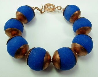 Large beaded cobalt blue polymer bracelet with forged copper bead caps