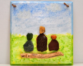 Mother, Father and child in meadow