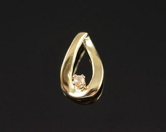 10K 0.04 Ct Diamond Free Form Pendant Yellow Gold