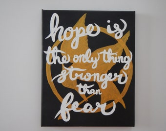 "Hand Painted Canvas Hunger Games Quote ""Hope is the only thing stronger than fear"""