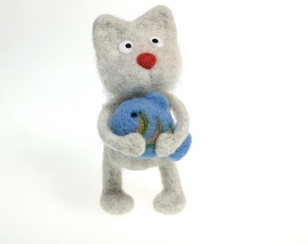 Cute needle felted cat with blue fish.