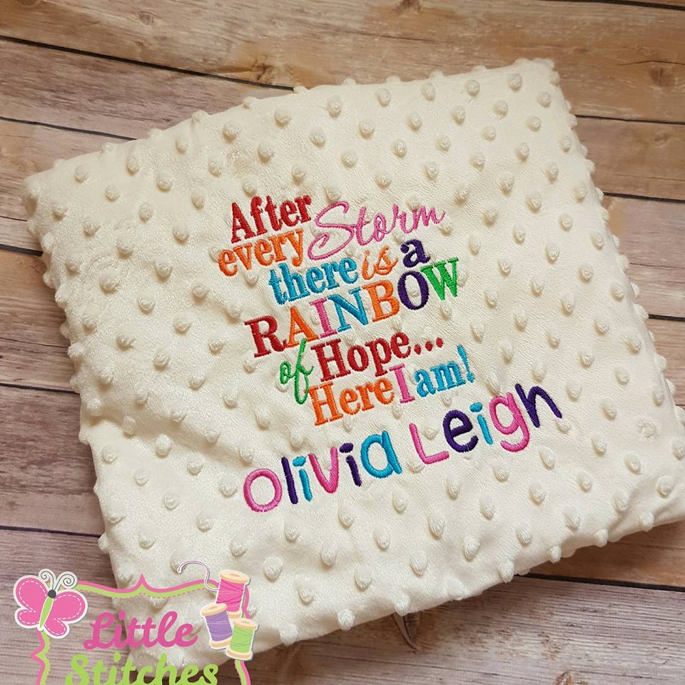 Personalised rainbow baby blanket embroidered with name and
