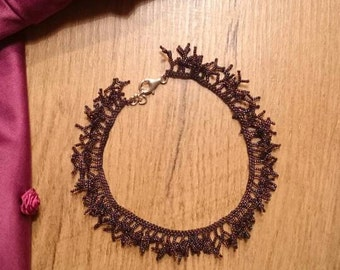 Handmade foot necklace made of glass beads in aubergine color