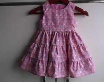 Ducks on pink dress