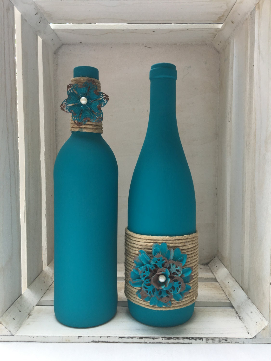 Teal chalk painted wine bottles with twine and metal flowers for Painted wine bottles