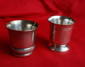 Two antique metal drinking cups made of silver plated metal