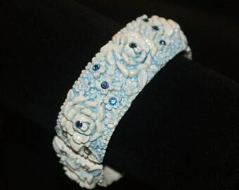 blue with AB RHINESTONES  Carved celluloid Plastic Clamper Bracelet VTG